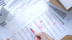 4K Taking Notes about Stock Martket Fluctuations - stock footage
