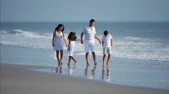 Latin American children spending leisure time with parents by ocean Stock Footage