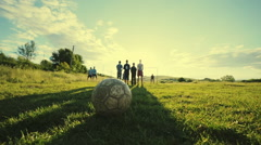 Penalties on the pitch. Rural white football young boys. Slow motion Stock Footage