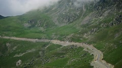 Transalpina mountain road in summer with cars and motorcycles passing by Stock Footage