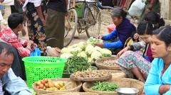 People buy and sell products on the street food market, Myanmar. Burma - stock footage