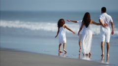 Latin American children spending leisure time with parents by ocean outdoors Stock Footage