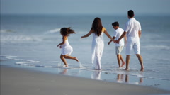 Spanish children spending leisure time with parents by ocean outdoor Stock Footage