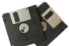 Two black floppy disks - stock photo