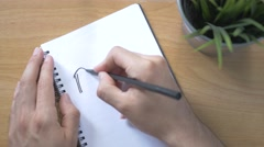 4K Top View Writing PLAN on a Notebook Stock Footage