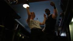 4K Fun bar staff dancing & enjoying the atmosphere in lively nightclub Stock Footage
