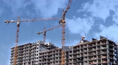construction skyscraper tower cranes in the clouds time lapse - stock footage