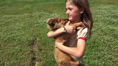 Child Walks Kissing and Hugging her Puppy, Child Playing with her Little Dog Stock Footage