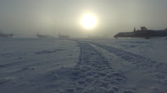 Track across frozen atmospheric siberian airport Stock Footage