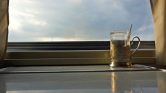 Cup holder on table near window in moving train Stock Footage