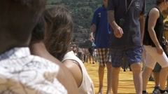 "Christo and Jeanne-Claude's ""Floating Piers"" - People Walking On The Pier Stock Footage"