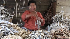 People buy and sell dry seafood and products on the street food market, Burma Stock Footage