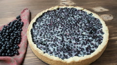 Blueberry pie sprinkle with powdered sugar , on the wood table Stock Footage