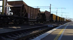 Freight train with many cargo containers runs on railway. - stock footage