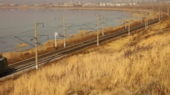 Freight train carrying  containers through scenic landscape. Stock Footage