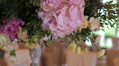 Beautiful wedding decorations to wedding. Beautiful flowers are on the table Stock Footage
