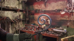 Blacksmith working on metal on anvil at forge. Stock Footage