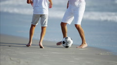 Young Spanish male parent and son having fun on beach holiday Stock Footage