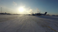 Track across frozen siberian airport in sunset Stock Footage