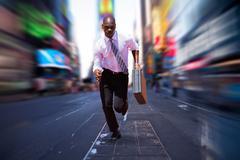 Businessman running against blurry new york street Kuvituskuvat