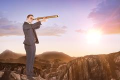 Businessman looking through telescope against clouds - stock photo
