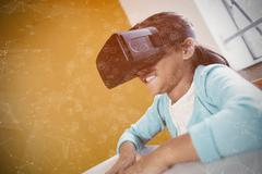 Sphere of icons against girl using a virtual reality device - stock photo