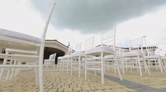 Dolly of rows of chairs at a wedding ceremony from the aisle and from the back Stock Footage