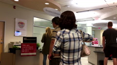 People line up for waiting service at rception and information counter Stock Footage