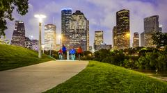 Houston City Skyline at Night & People in Park Stock Photos