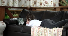 Girl Using Tablet Computer Lying on Leather Sofa on Terrace Stock Footage