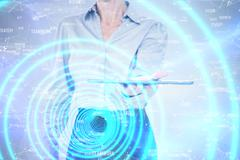 Businesswoman holding digital tablet against sphere of skills Stock Photos