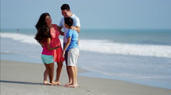 Latin American parents and children having fun on the beach holiday Stock Footage