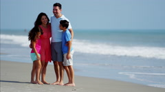 Spanish family spending leisure time together by ocean resort outdoors Stock Footage