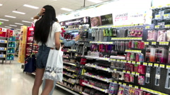 People looking health and beauty products in Walmart store Stock Footage