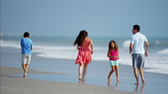 Young Hispanic family spending leisure time on beach vacation Stock Footage