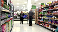 People looking for potato chips in Walmart store with 4k resolution Stock Footage