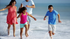 Latin American family having vacation fun on the beach Stock Footage