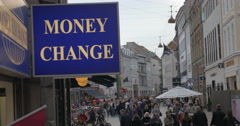 Banner of Money Change in busy street Stock Footage