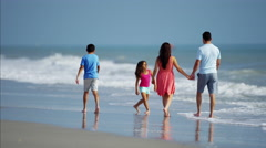 Cute Spanish children enjoying time with parents on beach holiday Stock Footage