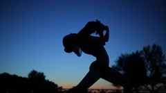 Sexy woman silhouette in twilight dancing with windy flying cloth Stock Footage