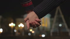 Young couple holding hands, interlocking fingers passionately, romantic date Stock Footage