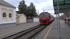 Suburban 4-car EMU train departs from the Perm I station heading to city center Stock Footage