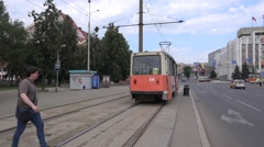 Two old orange trams meet at track turn from mixed traffic to segregation Stock Footage