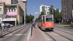Tram traffic along a street newly reconstructed for mass transit priority Stock Footage