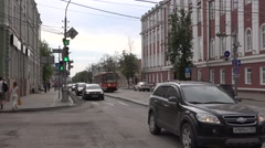 Tram runs in own right-of-way along a street under asphalt pavement repair Stock Footage