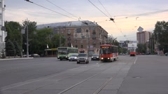 Oncoming trams cross a square in mixed traffic Stock Footage