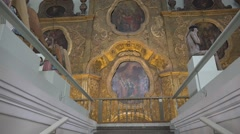 Former and future church building, now arts museum. Staircase and iconostasis Stock Footage