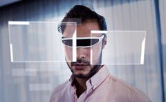 Interface against businessman using an oculus Kuvituskuvat