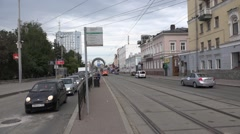 Tram runs own right-of-way and arrives to stop at Lenina Street Stock Footage