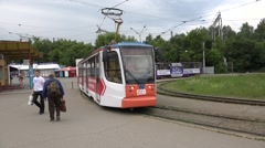 New KTM tram in advertising livery starts from a loop terminus Stock Footage